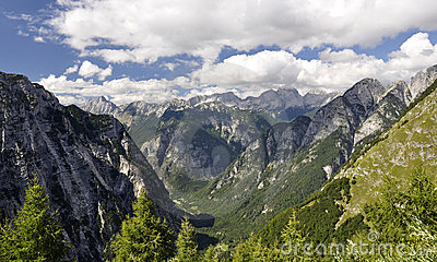 Blue and cloudy sky above Slovenian Alps