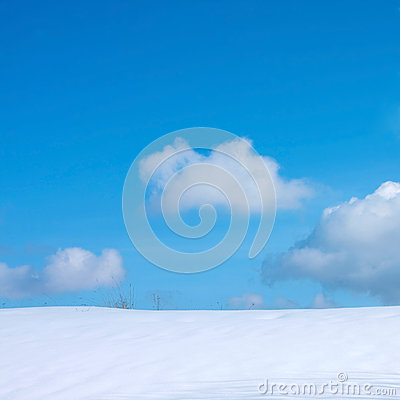 Blue cloudy sky and snow