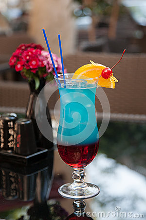 Blue cocktail on table