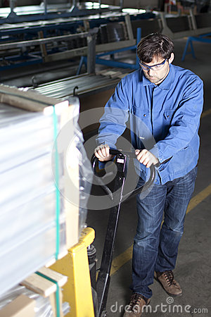 Blue collar worker with pallet