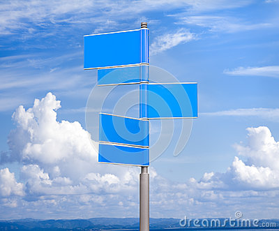 Blue color blank signs against blue sky