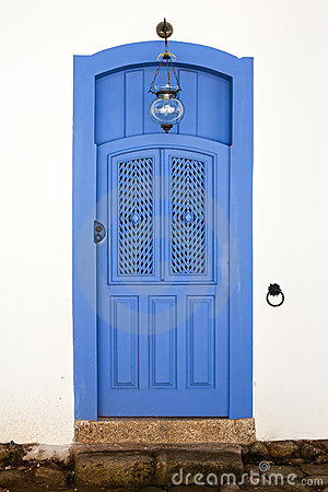 Blue colorful front house door in parati brazil