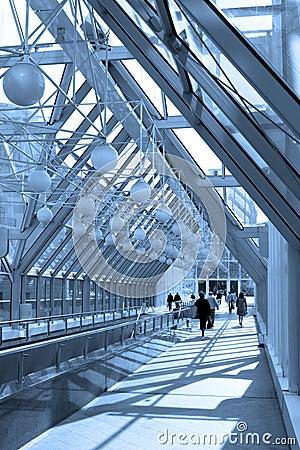 Blue corridor, spheres and people