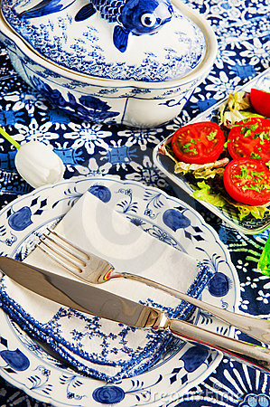 Blue crockery with fresh tomatoes