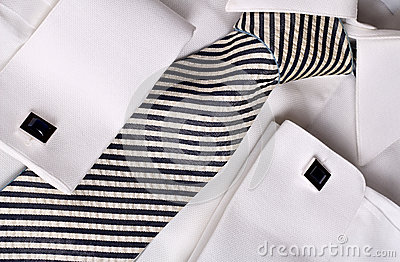 Blue cuff links on white shirt
