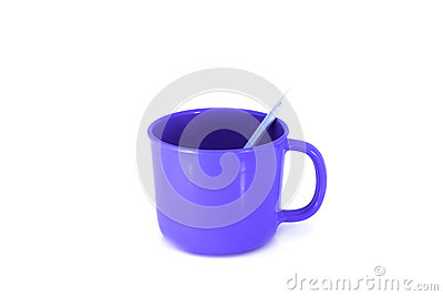 Blue cup with spoon  on white