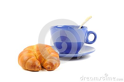 Blue cup with tea and croissant