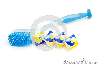 Blue dishwashing brush and tablets