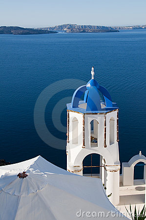 blue dome church harbor santorini greece