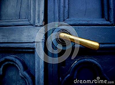Blue door with brass handle