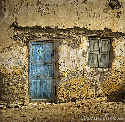Blue door on mud-brick house
