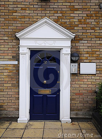 Blue door No.12 in old London houses in dockside