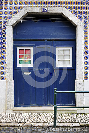 Blue door with portuguese flag