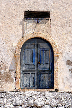Blue door with solar clock