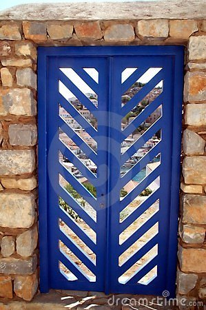 Blue door in stone wall Stock Photo