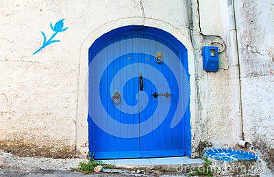 Blue Door in a White Wall