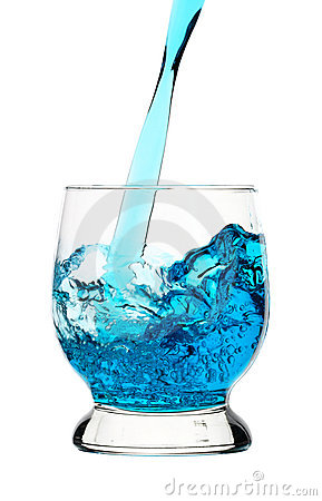 Blue drink is being poured into glass