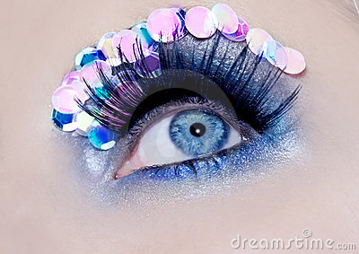 Blue eye macro closeup makeup sequins colorful