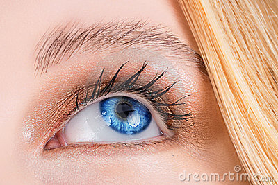 Blue eye of a woman.
