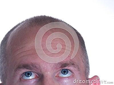 Blue Eyed Bald Man looking up 2