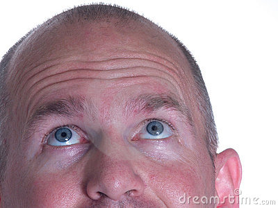 Blue Eyed Bald Man looking up one ear