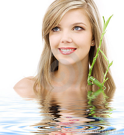 Free Blue-eyed Blonde With Bamboo In Water Royalty Free Stock Image - 5558226