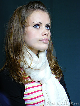 Blue-eyed brown-haired woman in a white scarf