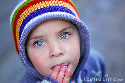 Blue eyed child looking up