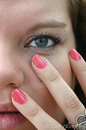 Blue-eyed girl with pink nails