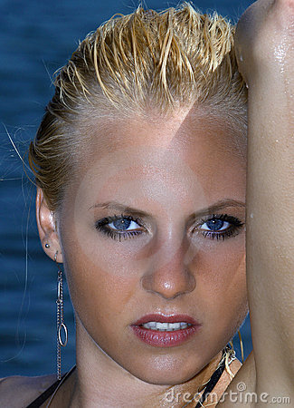Blue eyed girl in water