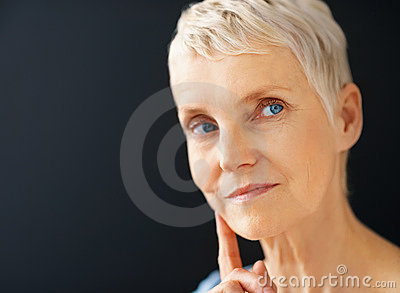 Blue eyed senior lady looking away from copyspace