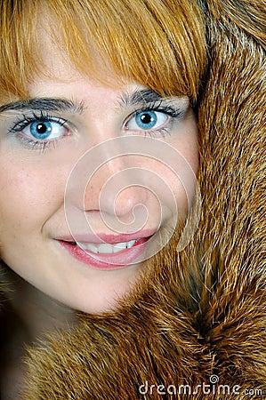 Blue-eyed woman in fox fur