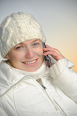 Blue-eyed woman on phone