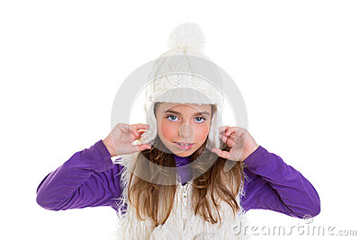Blue eyes child kid girl with white winter cap fur