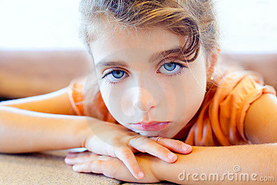Blue eyes sad children girl crossed arms