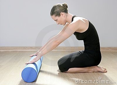 Blue foam roller pilates woman sport fitness