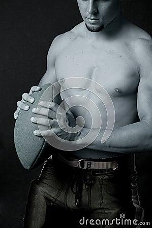 Blue football holding football