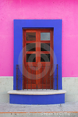 Blue framed door and pink wall