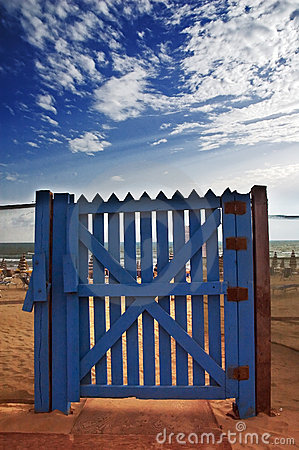 Blue gate on beach