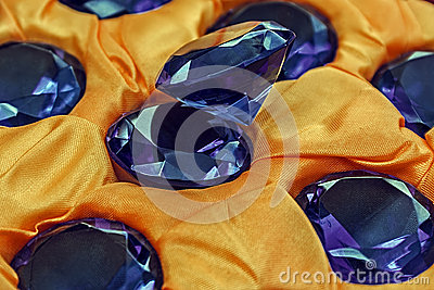 Blue gemstones and yellow cloth