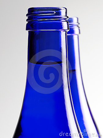 Blue glass bottle of soda