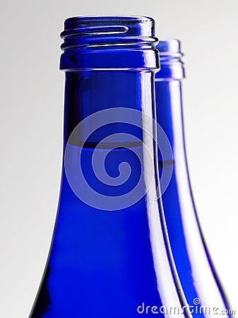 Blue glass bottle of soda