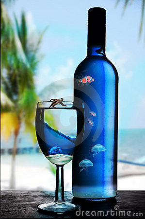 Blue glass and bottle of wine