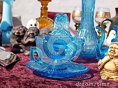 Blue glass items in a flea market