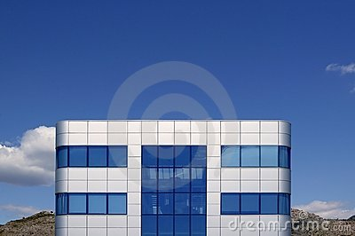 Blue glass and silver cubic architecture building