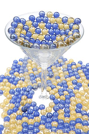 Blue and Gold marbles resting in a Martini Glass.