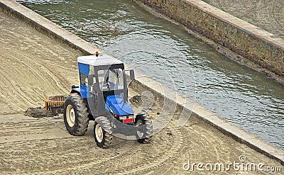 Blue grader tractor