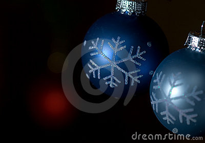 Blue and gray ornaments against dark background
