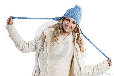 Blue hat on a blond girl, playing  hat s braids