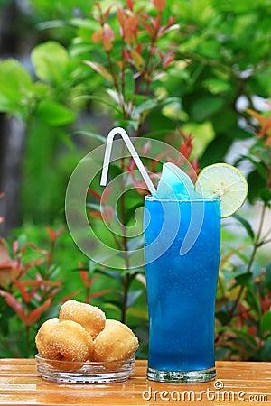 Blue Hawaiian cocktail with dessert